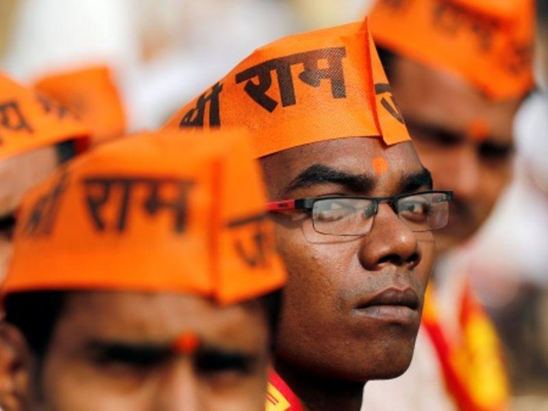A group of men wearing saffron cap.