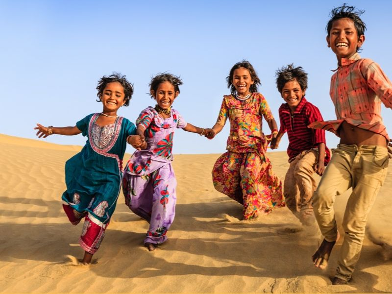Indian children holding hands