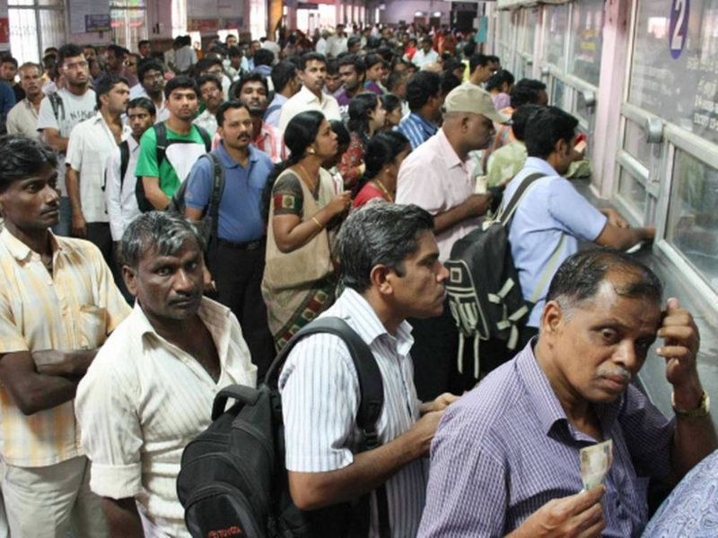 Huge crowd at train ticket booking office.