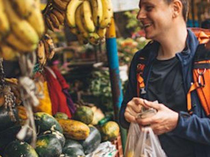 Travelers buying fruits